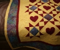 Some of my quilting detail...I traced heart patterns onto the fabric