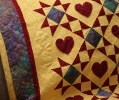 Lots of stipple quilting on this one...helped the hearts pop out