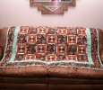 This quilt incorporated some southwestern type fabrics and resides in our living room during the winter months.